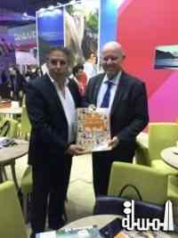 Beachcomber Hotels presents a copy of their -Sainte Anne Insight The Book- to Minister St.Ange of the Seychelles